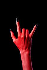 Devil hand showing heavy metal gesture