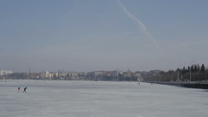 Frozen lake in the sity