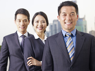asian business team, focus on man in front