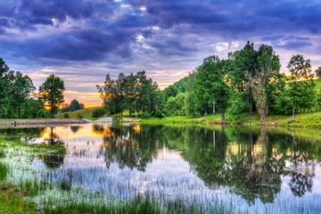 Idyllic scenery of lake at sunset