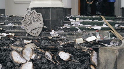 Burned documents at door of the prosecutor's office