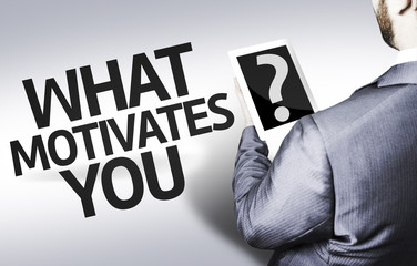 Business man with the question What Motivates You?