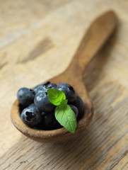Blueberries fruits on a wooden spoon