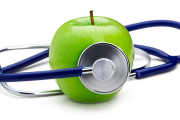 Green apple with stethoscope