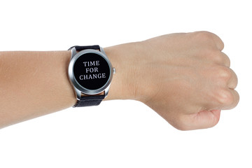 A hand wearing a black wrist watch. Time for change concept