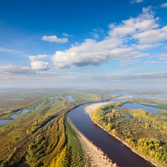 Terrain with great river in autumn, top view
