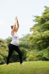 pregnant woman mother belly relaxing park yoga meditation