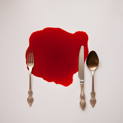 tableware and heart in a blood pool
