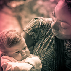 African Girl Embracing White Little Girl. Vintage Effect.