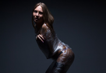 Photo of young wraped woman