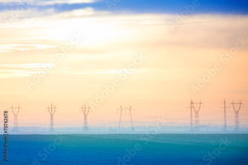 Hazy view of electricity poles in tender colors - 70762678