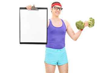 Athlete holding a clipboard and broccoli dumbbell