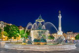 Romantic Lisbon street. Fountain at night in the center