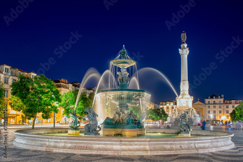 Foto op Aluminium Fontaine Romantic Lisbon street. Fountain at night in the center