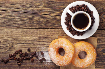 Sweet donut and cup of coffee