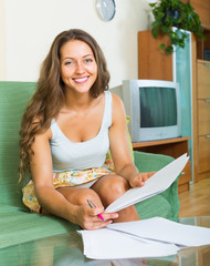 Woman filling papers at home