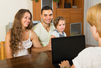 Banking assistant and satisfied family