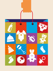 hand holding baby shopping bag with toy and cloth icons