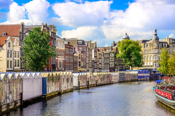 Scenic view of canal in Amsterdam at flower market
