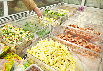 prepared vegetables and seafoods in shop freezer