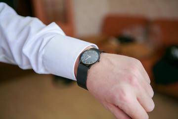 Man's watch on the wrist