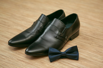 Bow tie and man's shoes