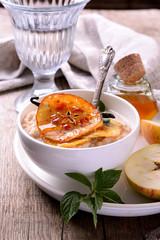 vanilla porridge of oatmeal with honey caramel apples slices