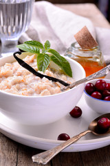 hot homemade milk oatmeal with natural vanilla and organic