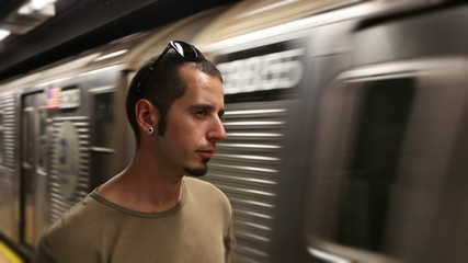 Young Man Waiting for Subway Train
