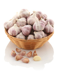 garlic in a wicker basket on a white background