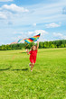 Beautiful blond girl with kite