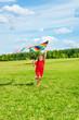 Beautiful blond girl with kite