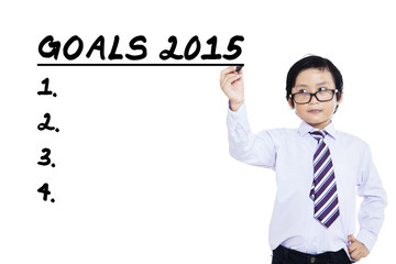 Little businessman makes business goals