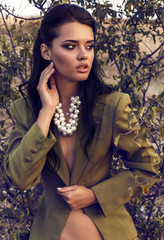 beautiful woman  in elegant jacket with accessory