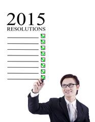 Smiling businessman writes resolution