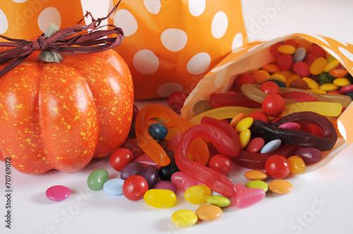 Fotobehang Snoepjes Halloween trick or treat candy on orange background