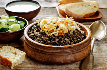porridge made with wild rice and black lentils with fried onions