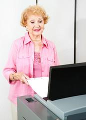 Senior Woman Votes Electronically