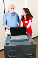 Young Volunteer Helps Voter