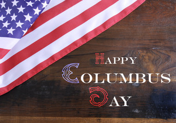 Happy Columbus Day text on dark wood background