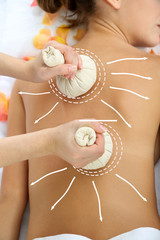 Back massage. Woman having back massage  (with arrows)
