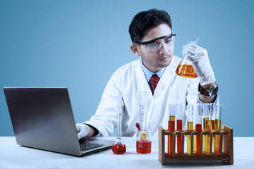 Young scientist doing experiment