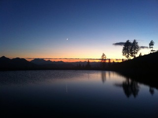 Mountain Lake Sunset Reflection With Moon
