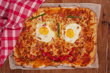 Pizza smiling face on wooden table