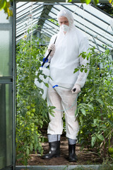 Garden worker in protective clothing