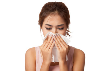Pretty Asian girl Caught Cold. Sneezing into Tissue.