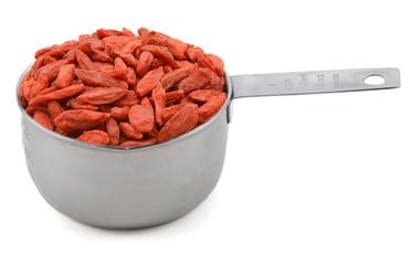 Red goji berries in a cup measure