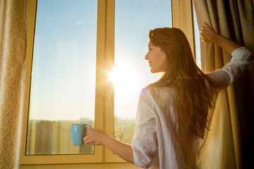 Woman in the morning. Attractive sexy woman with a cup of drink