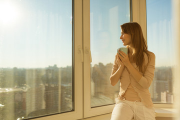 Woman in the morning. Attractive young woman with cup of tea