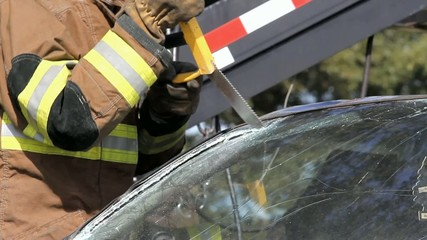 Fireman Sawing Car Windshield